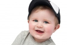 Boy smiling with hat photo