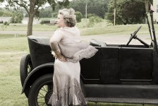 Woman standing by Model T