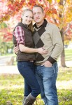 Gary and Courtney Engagement Photo - standing near red maple tree