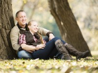 Gary and Courtney Engagement Photo - sitting by tree
